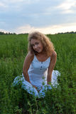 Picture of beautiful woman sitting on grass Stock Photo