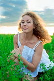 Picture of beautiful woman sitting on grass Royalty Free Stock Images