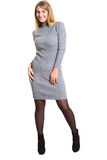 Picture of beautiful woman in wool dress. Isolated Stock Photography