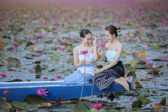 Beautiful woman with the red lotus sea Stock Photo
