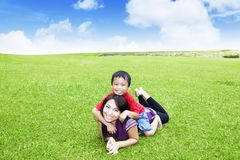 Beautiful woman playing with her son in park royalty free stock photography