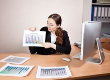 Businesswoman with financial reports at the office Stock Photography