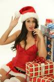 Pretty christmas woman wearing santa hat stock photography