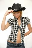 Young cowgirl with black cowboy hat royalty free stock image