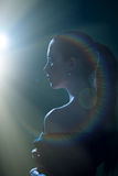 Picture of beautiful young woman on light flare Stock Photography