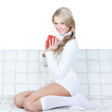 Picture of beautiful young woman with red cup Stock Photo