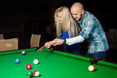 Picture of beauty couple in love plays pool billiard for the fir. St tima and having fun. Billiard sport concept. American pool billiard. Pool billiard game Royalty Free Stock Images