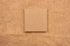 Picture of beige leather photo album cover on jute background. K Stock Photography