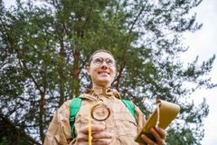 Picture from below of happy brunet with compass Royalty Free Stock Photos