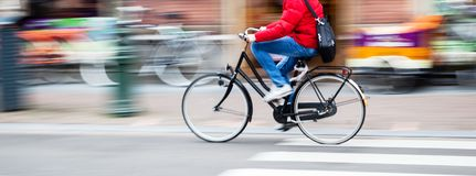Bicycle rider in the city in motion blur. Picture of a bicycle rider in the city in motion blur Stock Images