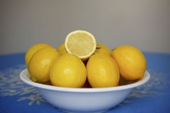 Large white bowl filled with yellow lemons Royalty Free Stock Photography