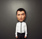 Picture of bighead man. Funny picture of bighead man over dark background Stock Image