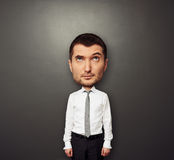 Picture of bighead man in white shirt Stock Photo