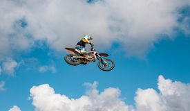 A picture of a biker making a stunt and jumps in the air. Extreme concept, adrenaline royalty free stock photo