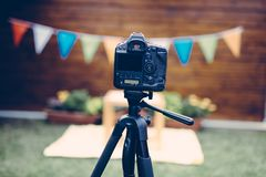Picture of digital camera placed on tripod. Picture of black digital camera placed on tripod Stock Image