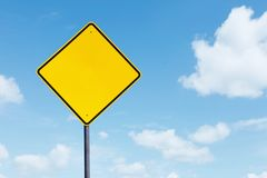 Blank yellow highway sign. Picture of a blank yellow highway sign under blue sky Royalty Free Stock Images