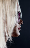 Picture of blonde in the dark room Royalty Free Stock Image