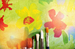Picture of blossom flowers painted by child. Painting brushes Stock Images