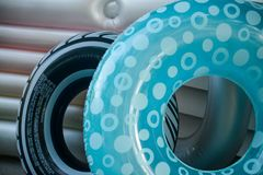 Blue black and gray Swimming tubes and rafts royalty free stock photography