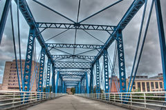 Picture of the blue bridge on a cloudy day stock photography