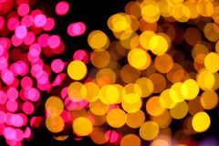 Picture blurred with Pink and yellow mix bokeh at night. Stock Image