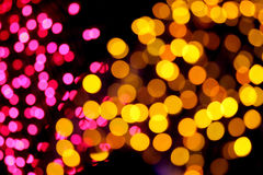 Picture blurred with Pink and yellow mix bokeh at night. Royalty Free Stock Images