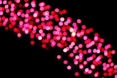 Picture blurred with red bokeh on black background. Royalty Free Stock Photos