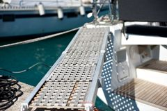 Yacht boarding ramp in marina stock photography