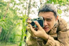 Picture of brunet with camera in woods Stock Photos