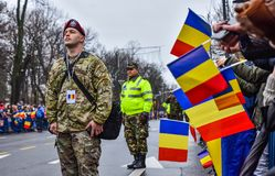 Romania National Day , american soldier. Picture from Bucharest, Romania with the military parade that took place at the Triomphe Arc on the occasion of the stock photography