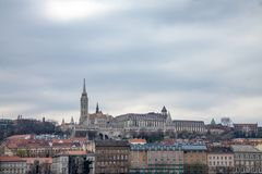 Buda Castle seen from Pest with the Matthias Church in front. The cast is the historical palace complex of the Hungarian kings stock photo