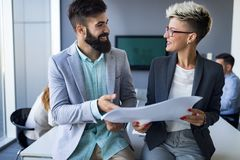 Picture of business colleagues talking in office. Picture of attractive business colleagues talking in office royalty free stock images