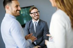 Picture of business colleagues talking in office. Picture of attractive business colleagues talking in office stock photography