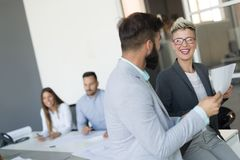 Picture of business colleagues talking in office. Picture of attractive business colleagues talking in office stock photo