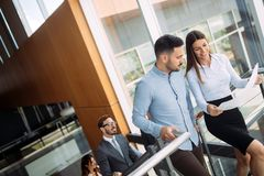 Picture of business colleagues talking in office. Picture of attractive business colleagues talking in office royalty free stock photo