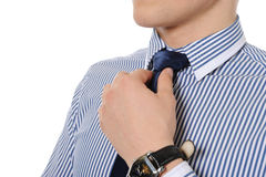Picture of a business man adjusting his tie Royalty Free Stock Photography