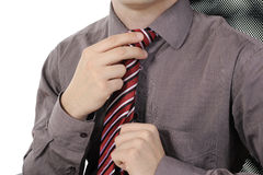 Picture of a business man adjusting his tie Stock Photos