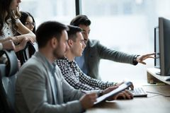 Picture of business people working together in office. Company stock photos
