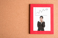 Picture of business woman in frame with graph on wooden table Stock Photography