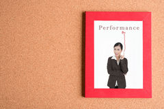 Picture of business woman in frame with word performance on wood Stock Photography