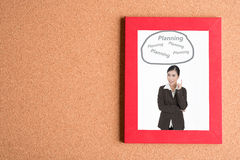 Picture of business woman in frame  with word planning on wooden Stock Photography