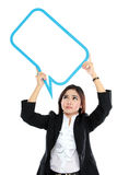 Picture of business woman holding blank text bubble in specs ove. R head on white background Royalty Free Stock Image