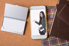 Picture of business woman in smart phone and blank name card and. Picture of business woman in smart phone and blank white name card and luxury holiday Stock Photography