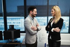 Picture of businessman and businesswoman talking in office. Picture of businessman and businesswoman talking in company office Royalty Free Stock Image