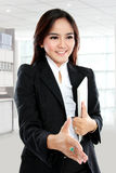 Picture of businesswoman with an open hand ready for handshake Royalty Free Stock Photography