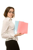 Picture of businesswoman in white demonstrating two folders Royalty Free Stock Photography