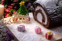 Picture of cakes with three blurred gift box for celebrate Christmas time. /Selective focus royalty free stock photo