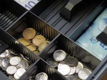 Spare change. A picture of a Canadian currency drawer. Spare any loonies, quarters, dimes, or nickels. How about a five dollar bill royalty free stock photography