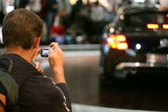 Picture of car. Man taking a picture a a dream car Stock Image