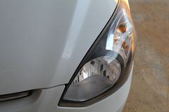 Headlamp of a car. Picture of a car headlamp with side indicator and glassy look curvy royalty free stock photos